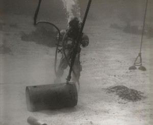 Navy Diver salvages unexploded munitions.